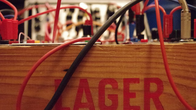 Picture of a self built DIY modular synthesizer in a lager box.